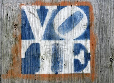 faded-colors-vote-sign-on-a-weathered-gray-plywood